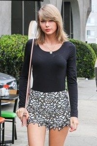 Taylor Swift looking like a 1960s nordic secretary