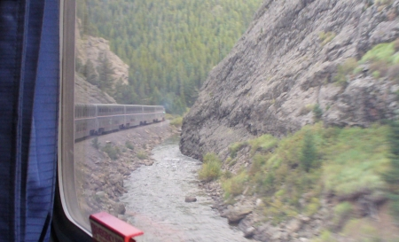 my train by a river in a canyon