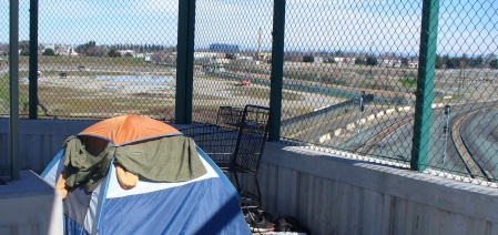 homeless tent overlooks the railyards