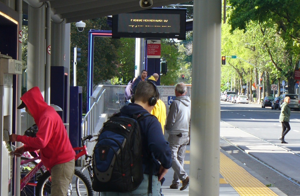 people at the light rail stop Friday morning