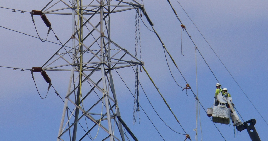 men work on power lines